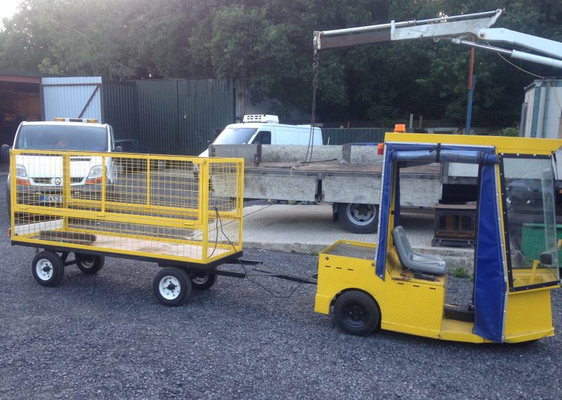 Yellow Electric Vehicle Tug and trailer